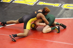 Wrestlers Take Opponents to the Mat