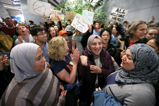 From left, Khaleah Tahan, of Daly City, Kerry McCracken, of Oakland, Bayan Tahan, of Daly City and her mother Rawa Alchalian, of Daly City, protest with hundreds of other people against the detention of Muslim refugees at San Francisco International Airport in San Francisco, Calif., on Saturday, Jan. 28, 2017. Tahan has family from Syria, they said. U.S. President Donald Trump signed an executive action prohibiting Muslims from entering into the United States. (Ray Chavez/Bay Area News Group)
