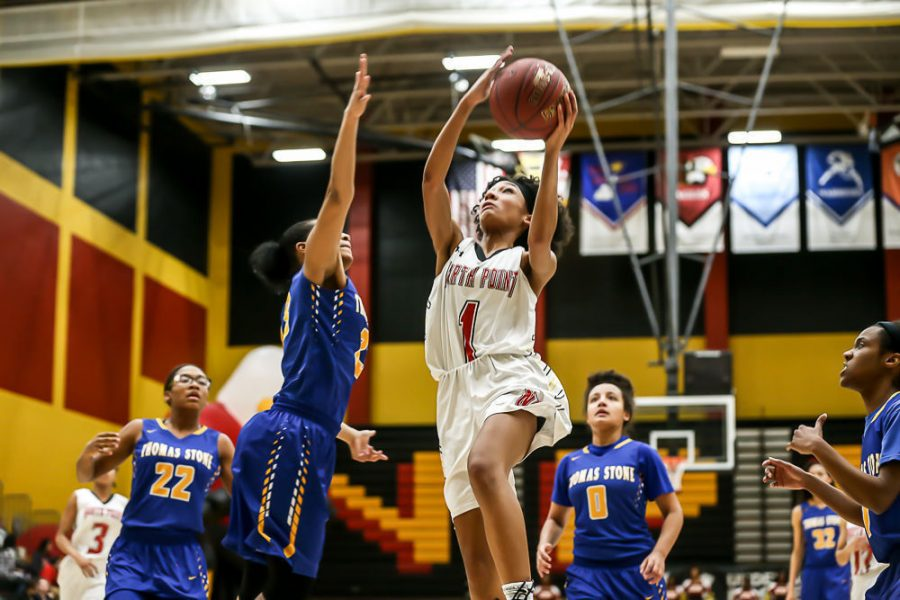 Synia Johnson (20) going for a fast break layup against the Cougars.