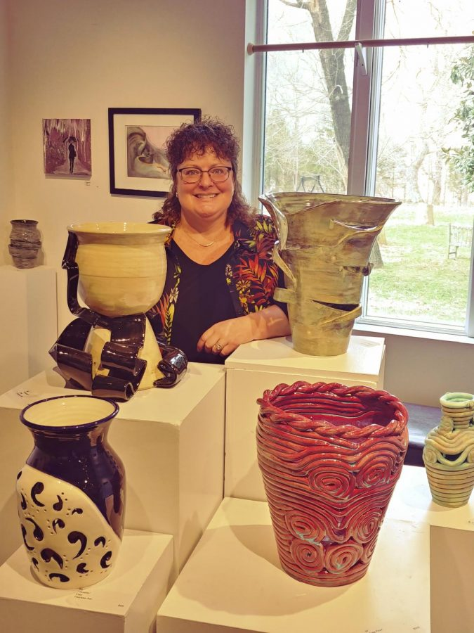 Dr. Alo stands proudly with her favorite collection